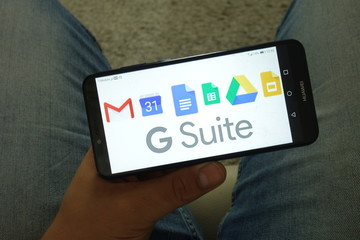 KONSKIE, POLAND - June 29, 2019: Google Suite including Gmail Calendar Docs Sheets Drive and Slides logos on smartphone