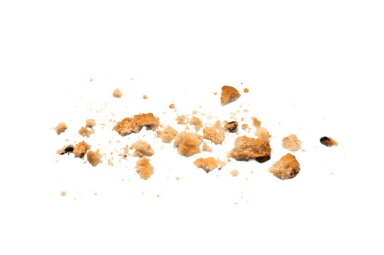 Scattered crumbs of chocolate chip cookies isolated on white background. Sweet biscuits delicious and crunchy homemade pastry.