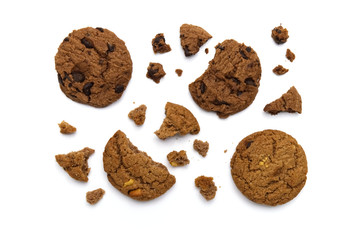Chocolate chip cookies and crumbs on white background and Top view.