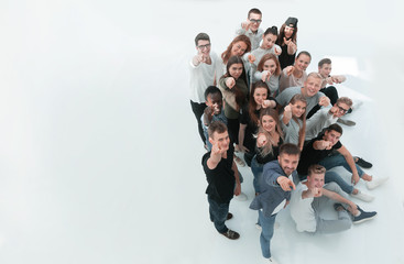 top view. group of happy young people looking at the camera