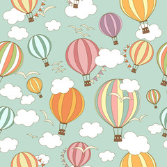 Multicoloured striped hot air balloons with buntings, birds and clouds in the sky. Seamless pattern. Cute background, kids wallpaper. Vector illustration in cartoon style