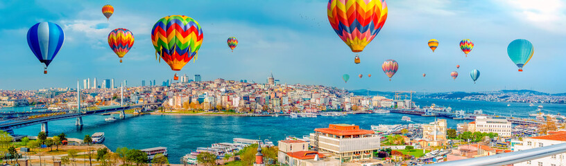 Poster de jardin Montgolfière / Dirigeable Galata Tower, Galata Bridge, Karaköy district and morning hot air balloon over the Golden Horn, Istanbul - Turkey