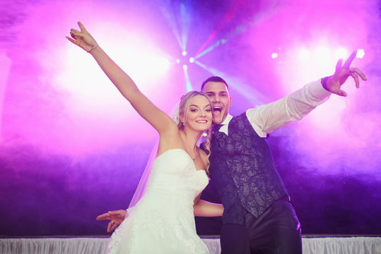 great party mood at the wedding - bride and groom celebrate