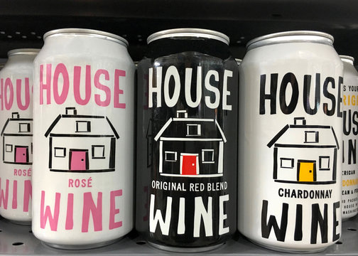 Anaheim, CA - September 29, 2017: Grocery store shelf with cans of House Wine in a can. House Wine is launching three wines in 375 mL cans nationwide this in May 2017.