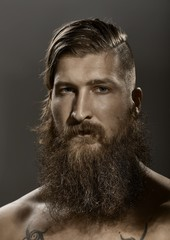 Portrait of a young stylish bearded man