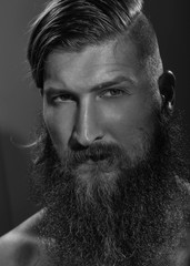Black and white portrait of a young bearded man