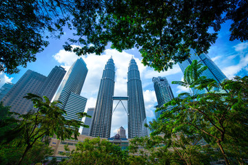 KUALA LUMPUR, MALAYSIA - Nov 11, 2019. Petronas Twin Towers skyscraper at daytime on November 11, 2019. The tallest building in the world and remain the tallest twin towers in the world.