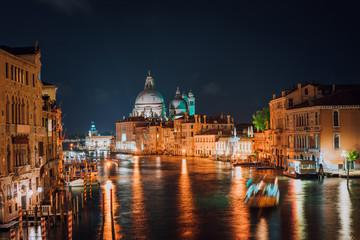 Venice, Italy. Majestic Basilica di Santa Maria della Salute at night. Grand Canal light reflected on water surface.