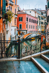Venice, Italy. The bridge and the colored houses on the shore of a narrow channel