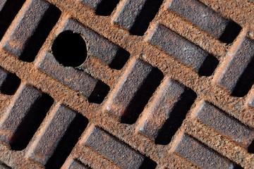 Closeup of manhole cover's geometric shapes