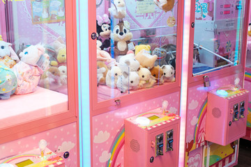 Slot machine with crane to grab and win soft toys in Hong Kong, November, 2019