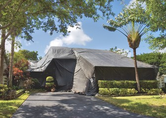 A residential dwelling is tented to exterminate termites and other insects.