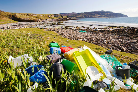 Plastic rubbish washed up at the singing sands on the west coast of the Isle of Eigg, Scotland, UK.