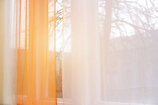 curtain window with sunlight in early morning