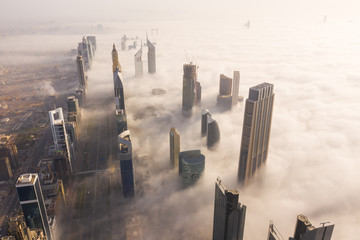 Aerial view of buildings surrounded by clouds Dubai, United Arab Emirates