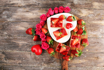 Wall Mural - strawberry cake and many fresh strawberries on rustic table with hearts and roses for valentines day.
