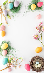 Top down vertical view of an Easter border frame including robin's eggs and chocolate eggs with copy space in the middle