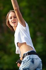 portrait of Beautiful teenage girl rollerskating in park