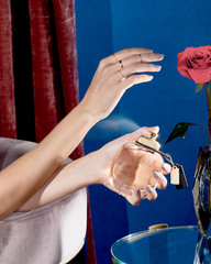 Close up of woman's hands spraying perfume