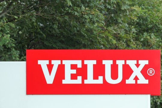 Ostbirk, Denmark - September 5, 2015: Velux logo at the entrance of a factory. Velux is a danish company that specializes in windows and skylights