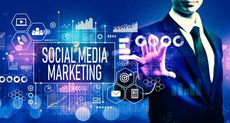 Social media marketing concept with businessman on blurred blue light background