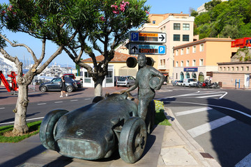 MONTE CARLO, MONACO - JUNE 24, 2016: Juan Manuel Fangio memorial at the Grand Prix circuit in Monaco. The statue depicts the 5-time Formula One World Champion standing next to his Mercedes-Benz car