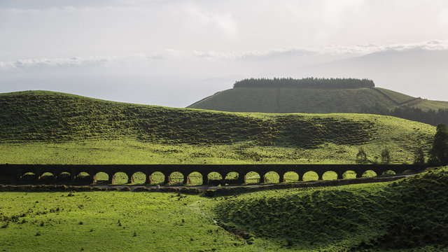 Historic Coal Aqueduct covered with plants and mosses in Sao Miguel, Azores, Portugal