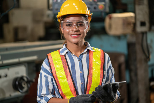 worker woman in warehouse. Professional team, quality control, stand maintenance, talk in the Warehouse factory. Team Engineer Factory operator Operating meetings