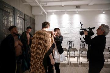 Designer Myriam Chalek adjusts a model before presenting the first Ryan's Secret men's underwear collection during New York Fashion Week
