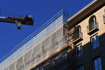 scaffold with safety net at a building