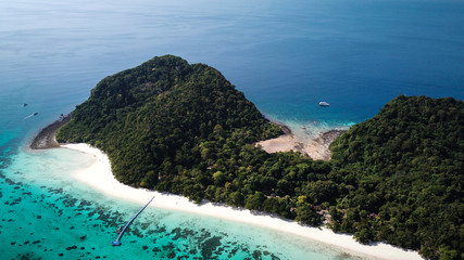 drone view of koh rok in thailand, white beach, coral reef and green jungle with turquoise ocean