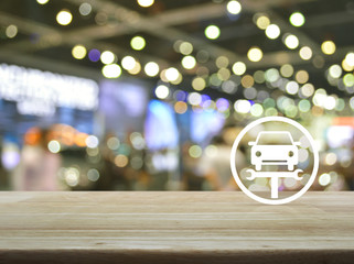 Service fix car with wrench tool flat icon on wooden table over blur light and shadow of shopping mall, Business repair car concept