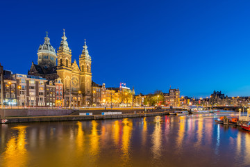 Amsterdam city skyline with landmark building at night in Netherlands