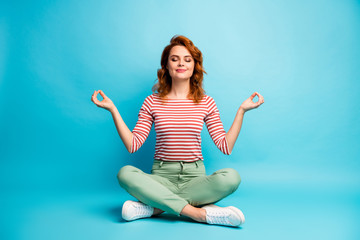 Printed kitchen splashbacks Zen Full size photo of quiet serene woman sit floor crossed legs show om sign exercise yoga meditation wear stylish green outfit isolated over blue color background