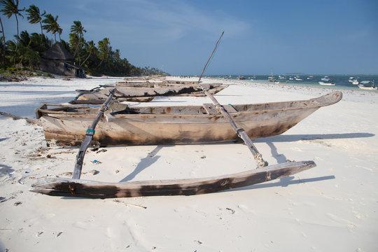 Wooden Catamarans on sandy beach in Zanzibar