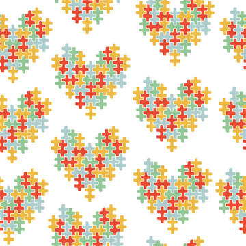 Seamless pattern for World Autism Awareness day. A colorful heart made of symbolic autism puzzle pieces.