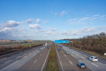 Highway Autobahn traffic aerial view in day time.