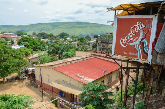 View over the Congolese river town Matadi with buildings and Coca Cola billboard