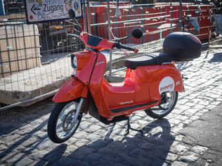 Electric rental scooter of company Emmy and model Schwalbe in street in Berlin, Germany