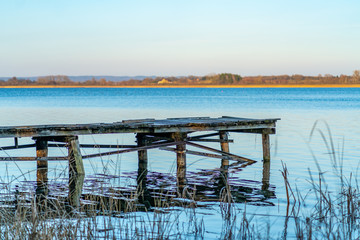 Old wooden landing stage at a tranquil lake