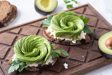 Fresh avocado rose toasts with cream cheese