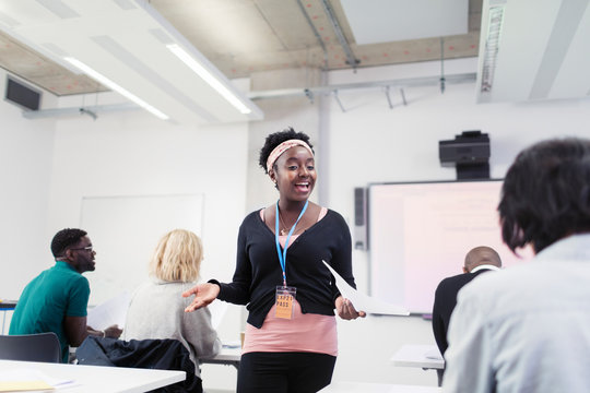 Smiling female community college instructor leading lesson