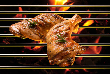 Wall Mural - Top view of grill bbq roast chicken thigh on the flaming grill