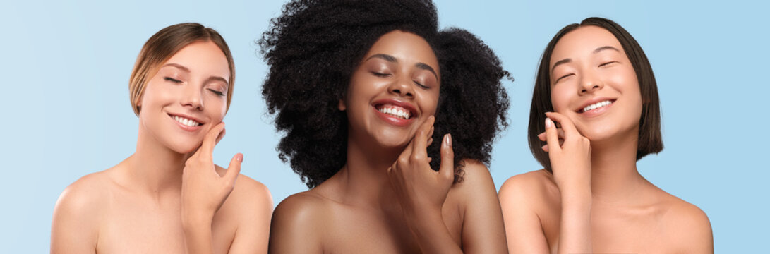 Optimistic multiethnic women applying cream on face