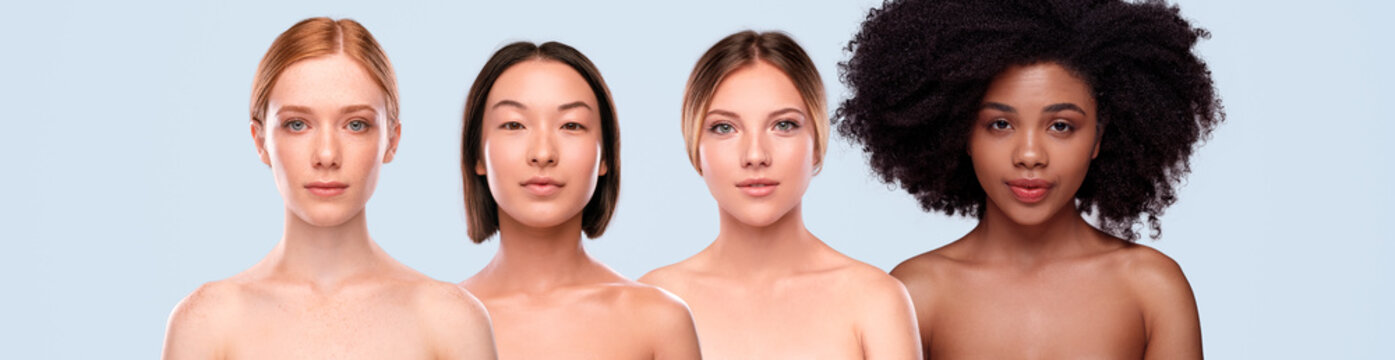 Multiracial women with clean skin looking at camera
