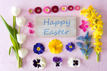 Sign With English Text Happy Easter. Flat Lay With Spring Flower Blossoms On Pink Wooden Background
