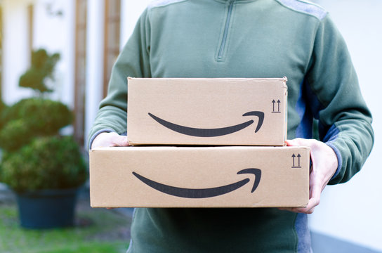 Soest, Germany - January 14, 2019:  Man delivers Amazon Prime package.