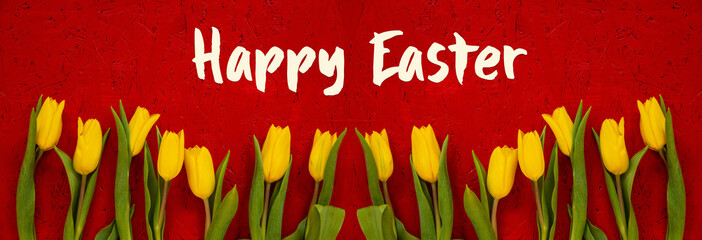 Red Wooden Background With English Text Happy Easter. Banner Of Yellow Tulip Flowers In Spring Season