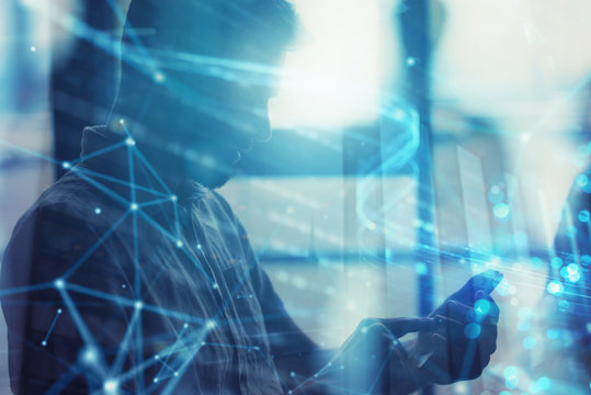 Young man using a mobile phone connected to internet. Double exposure and network effect