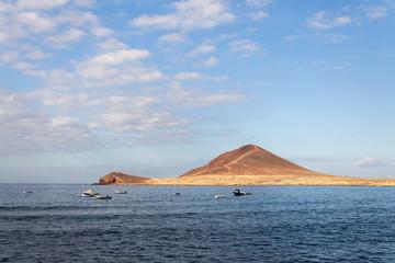 Montana Roja mountain on Tenerife coast near El Medano, Canary Islands, Spain, sunny summer day